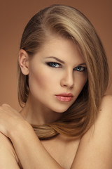 Long hair salon model. Beautiful blonde with professional makeup