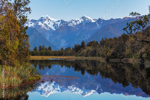 Poster Oceanië Twin Peaks reflect in the beautiful Lake Matheson, New Zealand
