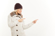 Cute Blonde In Winter Clothes Pointing Away