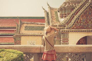 Young woman exploring asian palace