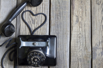 Old retro telephone with heart shape abstract concept
