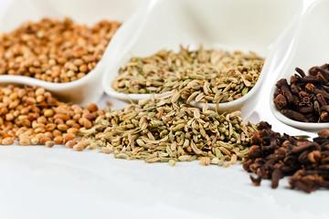 spices in  small ceramic cups
