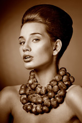 Beautiful woman with fresh Brussels sprouts. Professional makeup