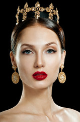 Beautiful woman model with professional makeup, in jewelry. Gold