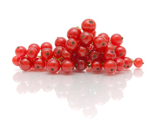 ripe juicy red currant berries on a white background with reflec