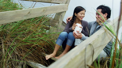 Loving Asian Chinese Couple Alone Drinking Coffee Fall Beach