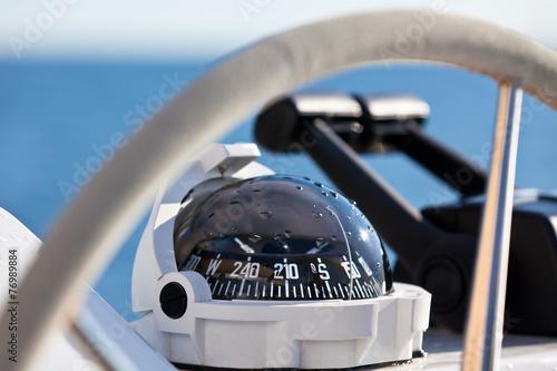Leinwandbild Motiv Sailing yacht control wheel and implement