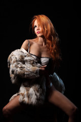 Photo of sexual beautiful girl is in fashion fur coat