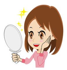 鏡を見て喜ぶ若い女性