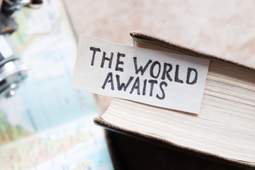 text The World Awaits, travel concept