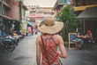 Young woman walking on th estreet in asian country