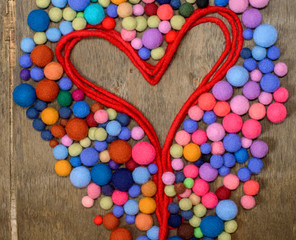 red heart  and multicolored beads