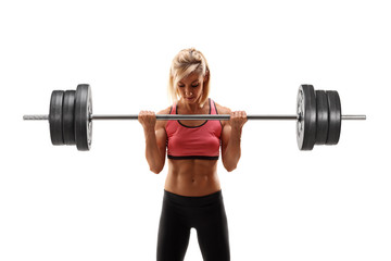 Female bodybuilder exercising with a barbell