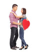 Girl holding a red heart and her boyfriend