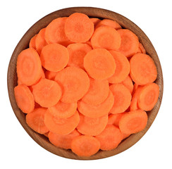 Carrot slices in a wooden bowl on a white