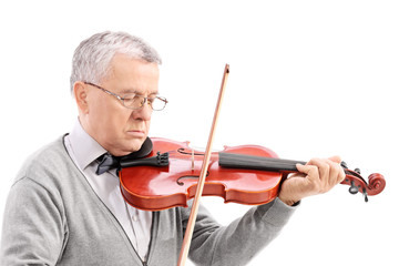 Mature man playing a violin