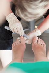 Toenails filing at beauty salon