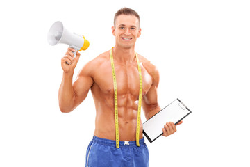 Young fitness coach holding a megaphone