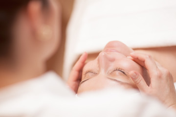 Woman getting professional facial massage