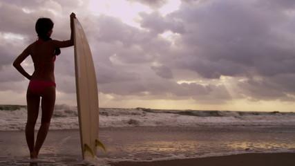 Ethnic Female Holding Surfboard Silhouette Sunset Beach