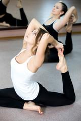 Yogi female doing backbends exercising in class