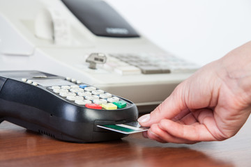 Close-up of cards servicing with POS-terminal