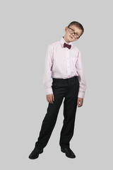 growth portrait of a boy in a tie and glasses