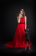 Lady in red with doberman