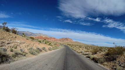 POV road trip Red Rock Canyon vehicle Conservation area blue sky winter Nevada USA