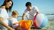 Young Caucasian Parents Baby Son Outdoors Sand Beach