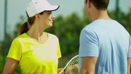 Young Caucasian Male Female Outdoor Tennis Players