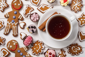 Cup of black tea with homemade cookies and chocolates, top view