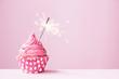 Leinwandbild Motiv Pink cupcake with sparkler