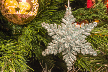 bright silver six point star decoration on christmas tree