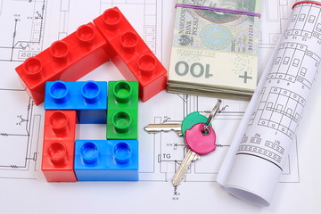 House of colorful building blocks, keys, banknotes and drawings