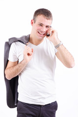Handsome young male model speaking on the phone