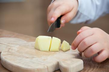 Child cutting an apple