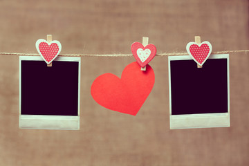 Two polaroid photo frames and heart for valentines day on vintag