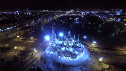 Orthodox church in the city center at night. Aerial