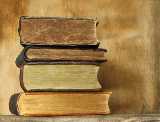 Ancient books on wooden background.