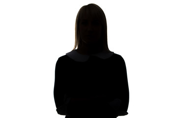 Silhouette of woman in dress with arms crossed