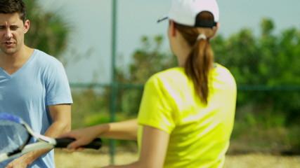Healthy Caucasian Couple Outdoor Tennis Court