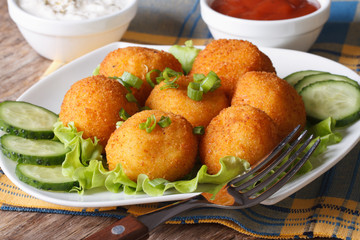 potato croquettes on a white plate close-up. horizontal