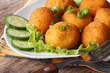 potato croquettes and vegetables close-up. horizontal