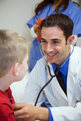Hospital: Doctor Listens To Boy's Heart In Exam Room