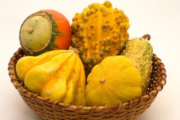 Decorative pumpkins in wicker basket