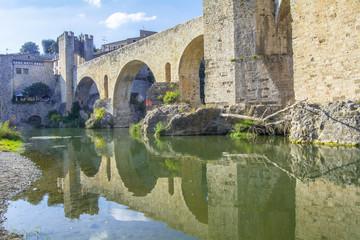 Reflection stone bridge over river