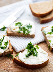 Sandwiches with melted cheese and herbs