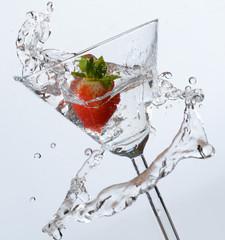 Strawberry Splashing Into Martini Glass