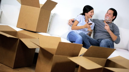 Happy Asian Chinese Couple Surrounded Home Moving Cartons